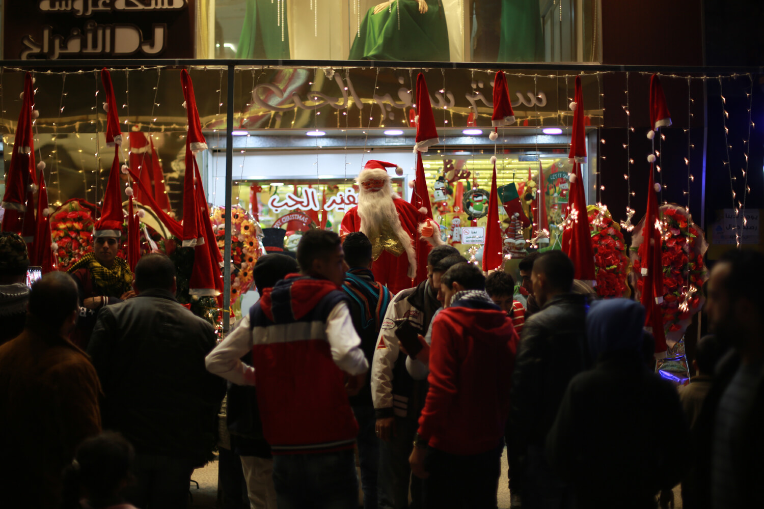 Citizens gathered in front of a special Christmas shops (Photo: Mohammed Asad)
