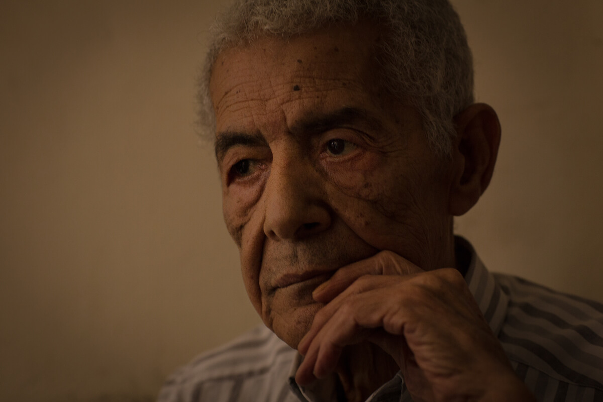 """Bourj el Barajneh Camp, Beirut, Lebanon - 15/10/2016: Taha Issa, 78 years old, lived in Haifa for the first 9 years of his life but can hardly recall any memories from this period, finding it too painful to remember his early years in Palestine: """"I can't actually repeat things, maybe I remember but it's been a long time, and to go back to memories is not easy."""" He sometimes sees activities organized by various groups in the camps that remind him of Palestine. (Photo: Celia Peterson)"""