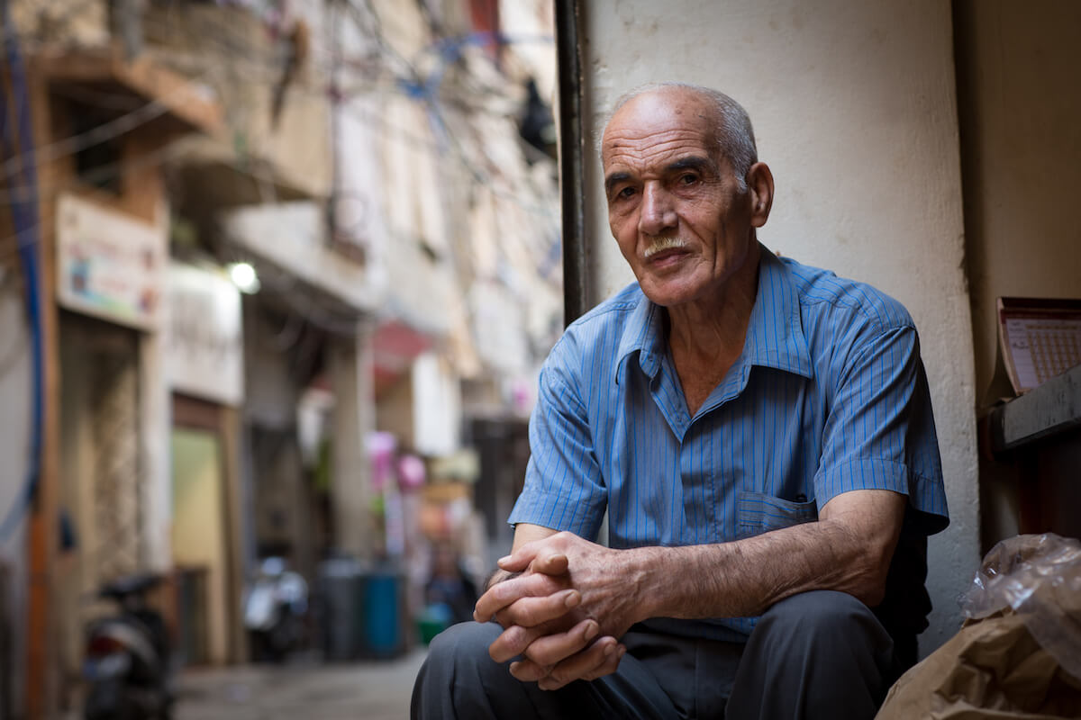 """Bourj el Barajneh Camp, Beirut, Lebanon - 15/10/2016: Hasan Awad, 73 years old, from Kweikat Qada in Akka, lived in Palestine for the first 4.5 years of his life and has lived in Bourj el Barajneh camp in Beirut, Lebanon ever since. """"I remember our house. We had apple trees around the house, 2 rooms and one kitchen. Nothing here resembles Palestine. Nothing at all. We had to adjust to the current atmosphere, and so our traditions were left behind."""" (Photo: Celia Peterson)"""