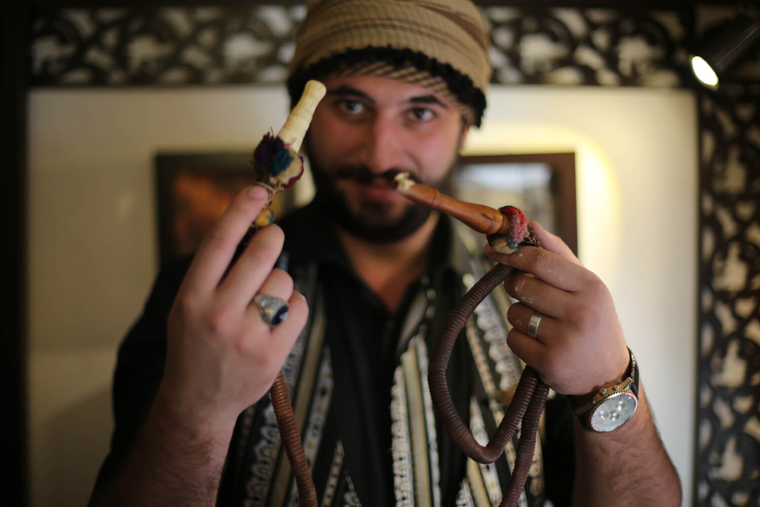 Qatarji holds a 150-year-old nargile hose made of ivory. (Photo: Mohammed Asad)