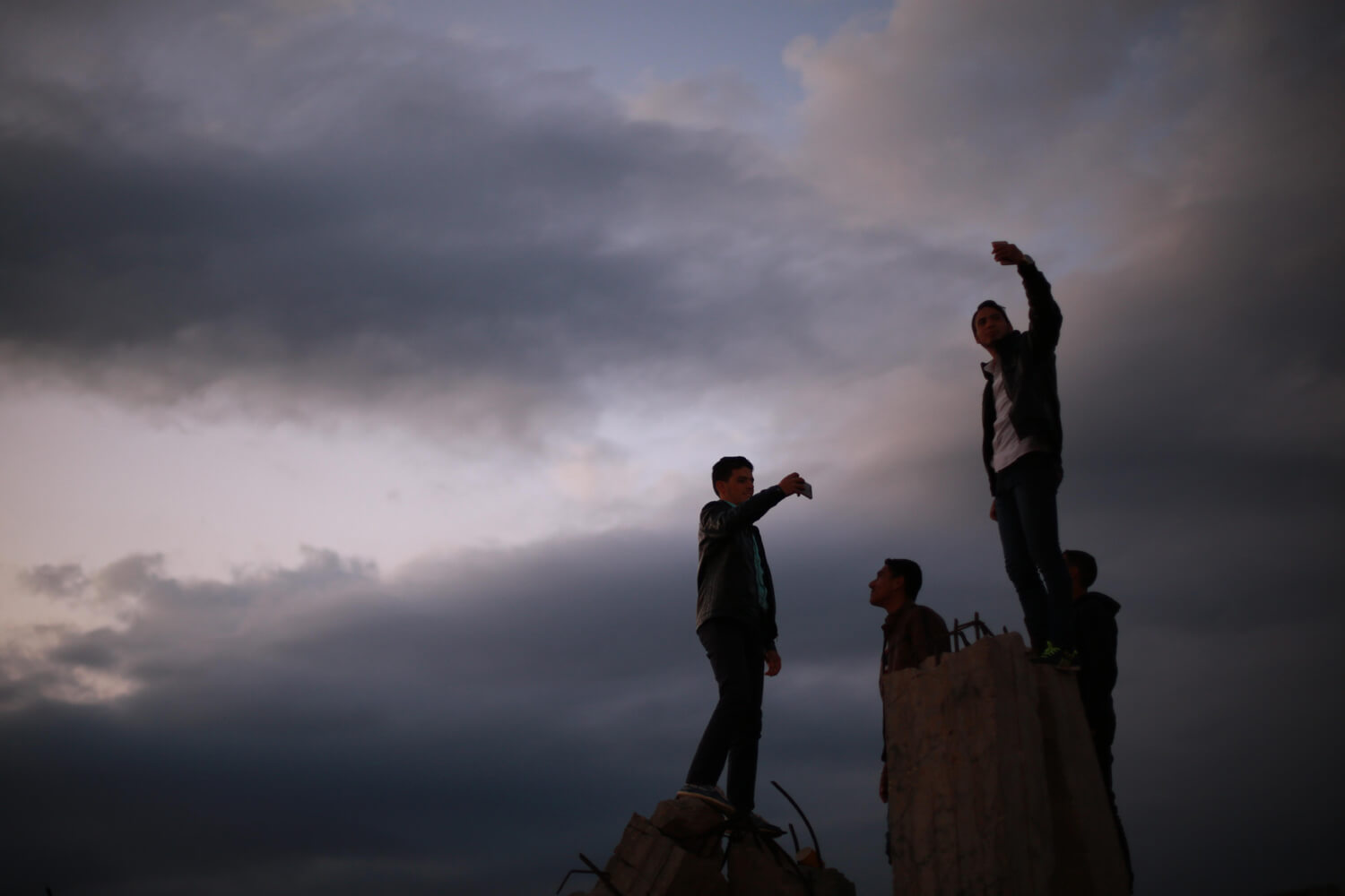 Youth take selfies with the sky as a backdrop (Photo: Mohammed Asad)