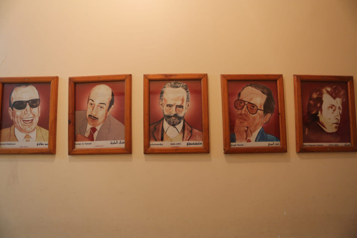Pictures hang in the school of famous Western and Arab composers and musicians (Photo: Mohammed Asad)