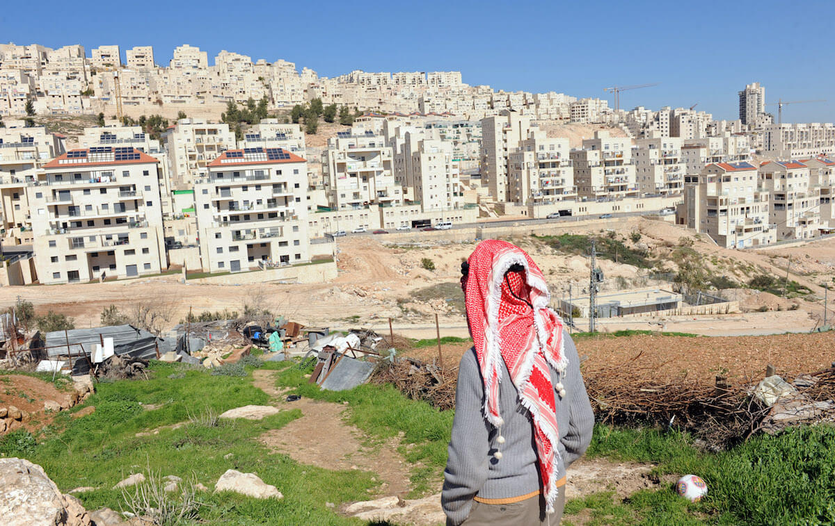 A Palestinian stands on his property overlooking the Israeli settlement Har Homa, West Bank, February 18, 2011. (Photo: UPI/Debbie Hill)