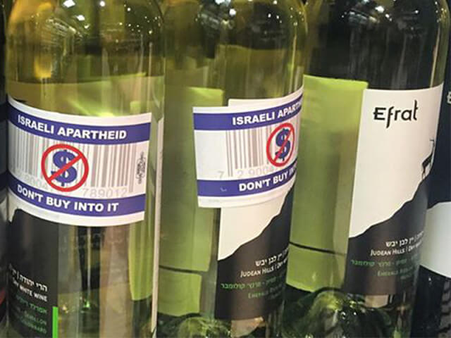 "Activist labels pasted across wine produced in the West Bank Israeli settlement of Efrat, originally labeled as ""made in Israel."" The Canadian liquor board will now require Israeli wines produced in settlements to carry the origin tag ""made in the West Bank occupied territory."" (Photo: Facebook/Canadian Jewish News)"