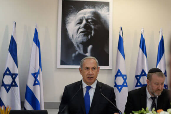 Prime Minister Benjamin Netanyahu stands in front of a portrait of Israel's first prime minister, David Ben-Gurion. (Photo: Kobi Gideon/GPO)