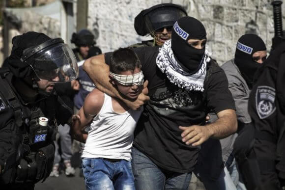 File photo of a Palestinian child being arrested in Jerusalem, from the Addameer Prisoner Support and Human Rights Association site.