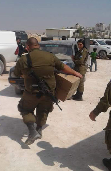 Israeli soldiers taking property of Jabal al-Baba. Photo from Pope Mountain Facebook page.