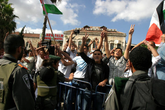 Israeli police prevented Palestinian demonstrators as they try to disperse a protest against a parade marking Jerusalem Day, in front of Damascus Gate outside Jerusalem's Old City May 20, 2012.