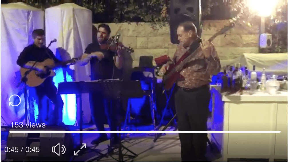 "Former Governor of Arkansas Mike Huckabee performs ""Sweet Home Alabama"" in Jerusalem on July 29, 2018."
