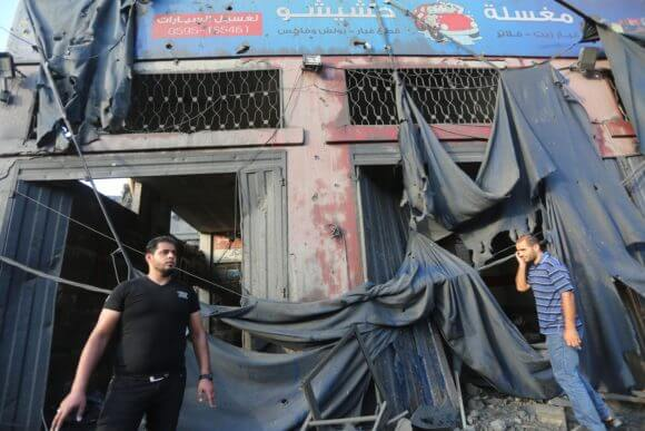 Ayman and Amna Hashishu's destroyed car wash business. (Photo: Mohammed Asad)