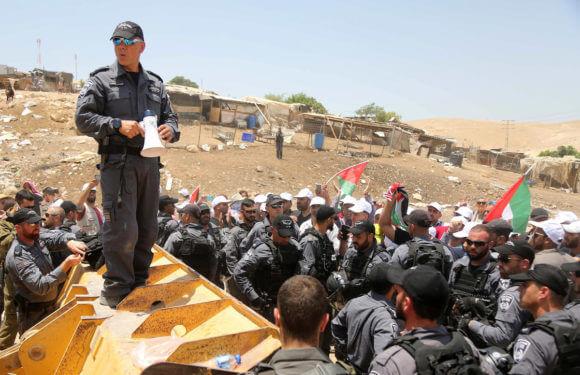 Israeli policemen scuffle with Palestinian demonstrators in the Bedouin village of al-Khan al-Ahmar east of Jerusalem in the occupied West Bank on July 4, 2018.