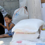 Palestinians receive food aid at an aid distribution center run by United Nations Relief and Works Agency (UNRWA) in Khan Younis in the southern Gaza Strip on September 4, 2018. The United States halted all funding to United Nations' agency that helps Palestinian refugees. State Department spokeswoman Heather Nauert said the business model and fiscal practices of the United Nations Relief and Works Agency (UNRWA) made it an ìirredeemably flawed operation. (Photo: Ashraf Amra/APA Images)