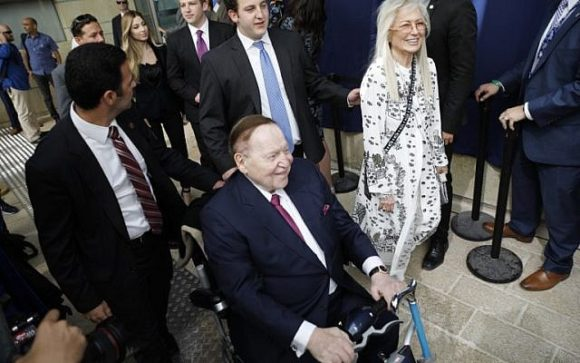 """Sheldon and Miriam Adelson at the opening of the US embassy in Jerusalem, May 14, 2018. Miriam wears a dress that bears message from biblical Psalms: """"If I forget thee Jerusalem, let my right hand forget its skill."""""""