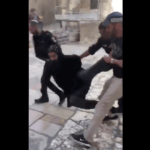 Israeli police arrest Coptic priests protesting outside of the Church of Holy Sepulchre in Jerusalem, October 24, 2018.