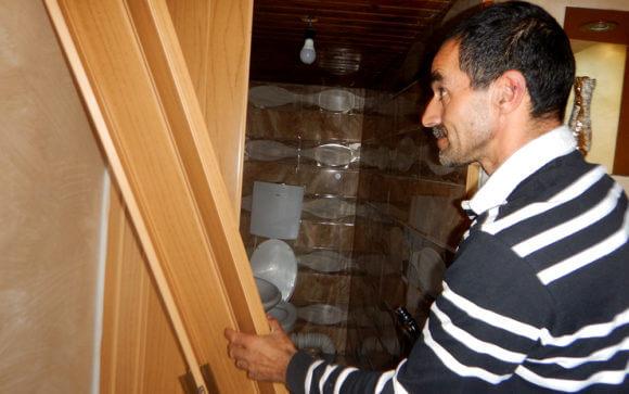 Jamal Karamah by the bathroom door the soldiers broke. Photo by Manal al-Ja'bri, B'Tselem, 24 Sept. 2018