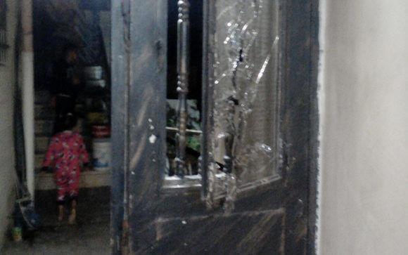 Little Tasnim Karamah, seen through the door the soldiers broke. Photo by Jannah Karama, 20 Sept. 2018