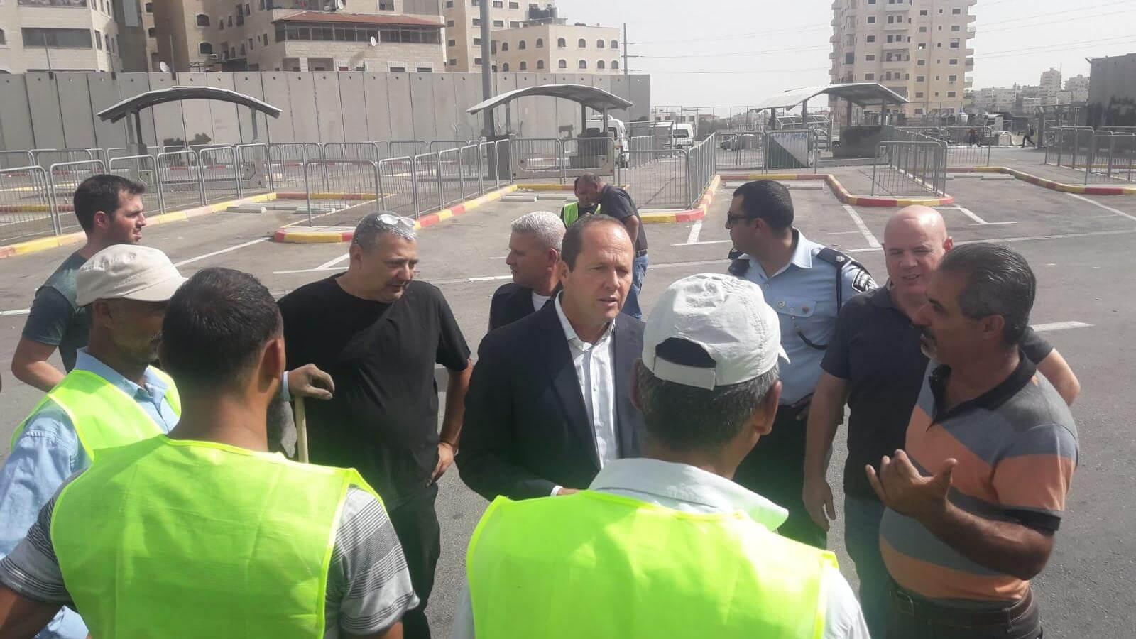 Jerusalem Mayor Nir Barkat (center) talks to municipal workers on October 23 in Shufat Camp.