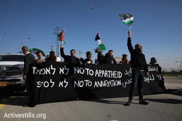 Protesters blockade the entrance to the 'Apartheid Road' in the West Bank on January 23, 2019.