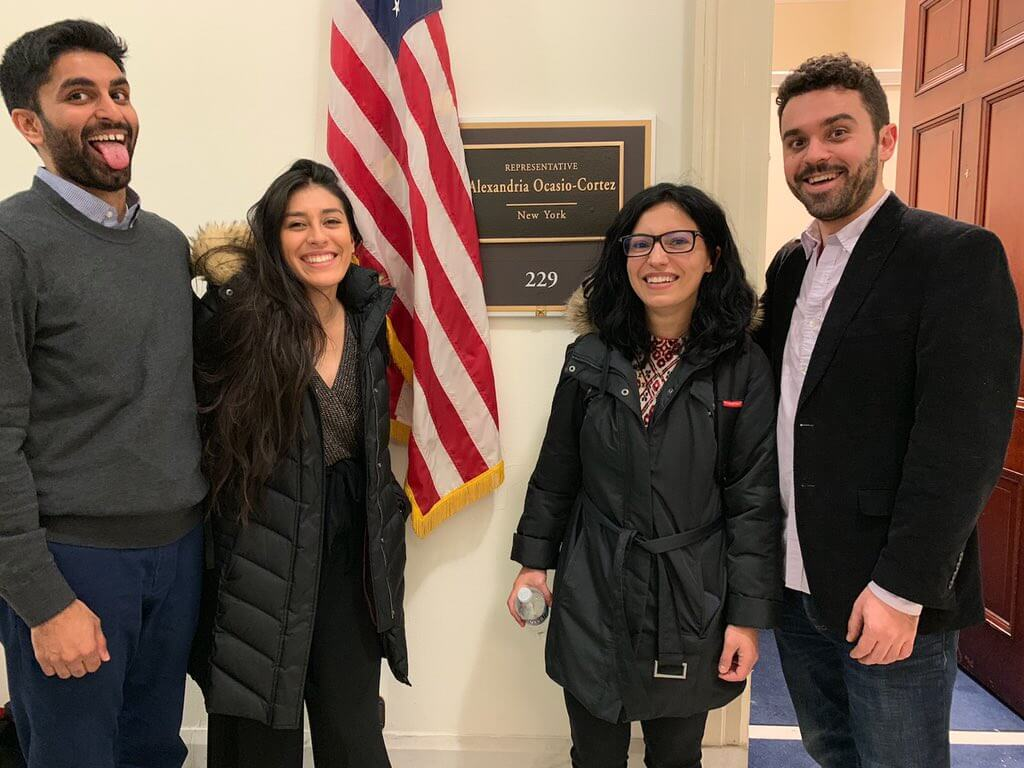 Members of Justice Democrats pose in front of Rep. Ocasio-Cortez's new Congressional office. (Photo: Alexandra Rojas, Twitter)