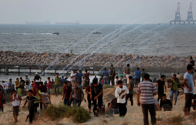 Palestinian demonstration on the beach near the fence, protesting against the naval blockade, September 2018. © Photo by Ashraf Amra