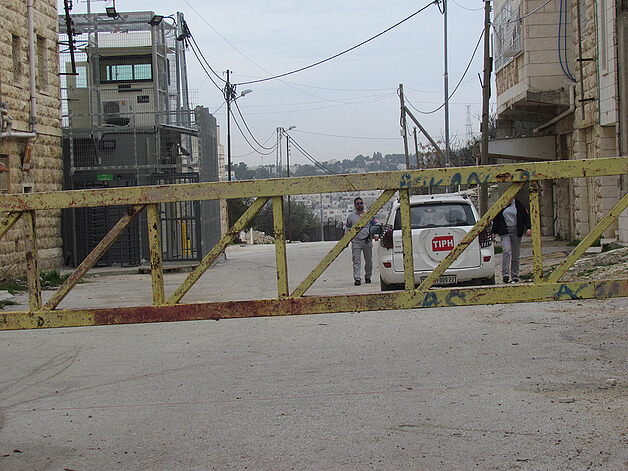 Temporary International Presence in Hebron (TIPH) at Israeli manned checkpoint (H2) Hebron. February 2018. (Photo by OCHA)