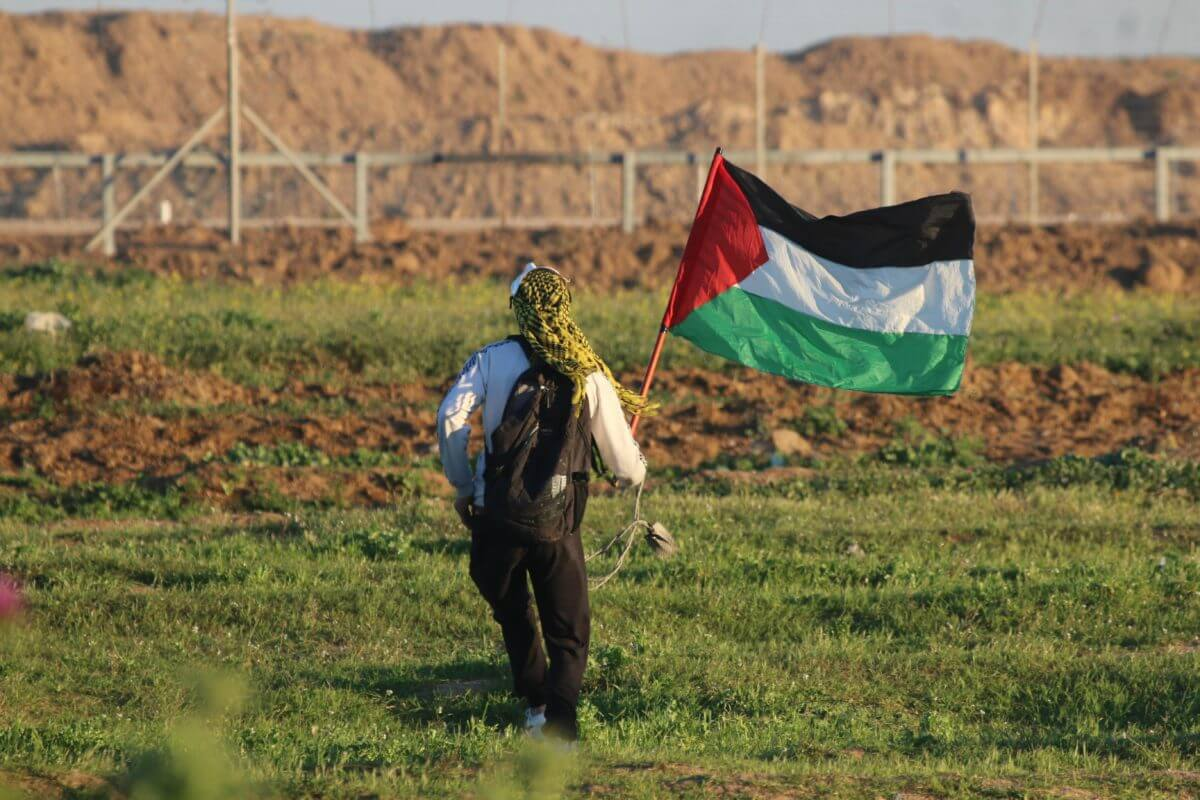 Protester facing the fence in Gaza
