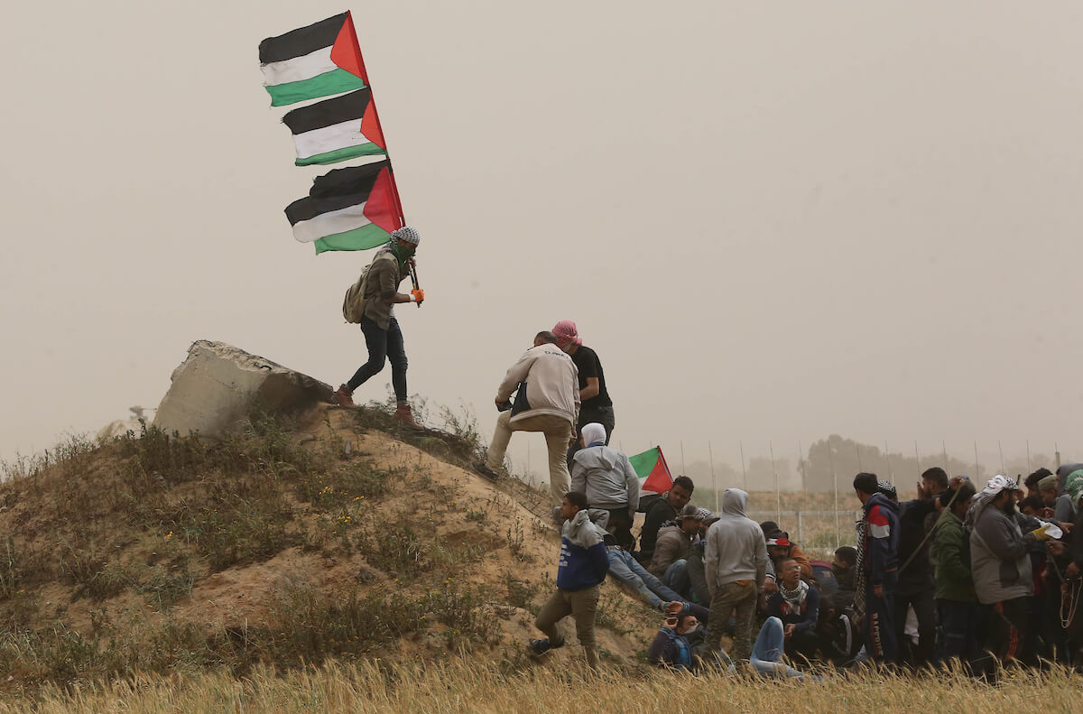 Palestinian protesters join the Great March of Return at the Israel-Gaza border in Khan Younis in the southern Gaza Strip