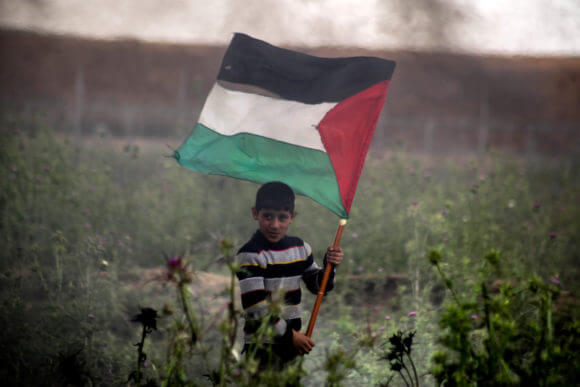 A Palestinian youth protesting as part of the Great March of Return in Jabalia in the northern Gaza Strip on March 30, 2019.