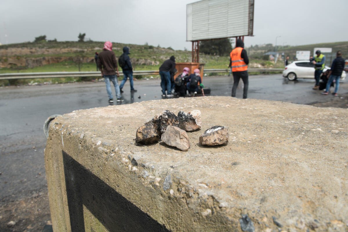 A collection of stones is seen on a concrete block during protests