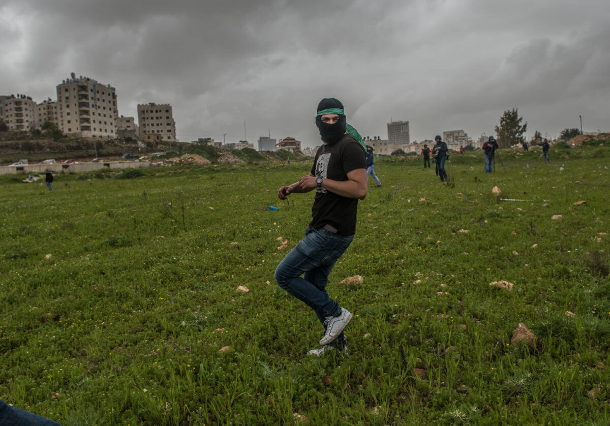A protester starts running as he hears the sound of live bullets.
