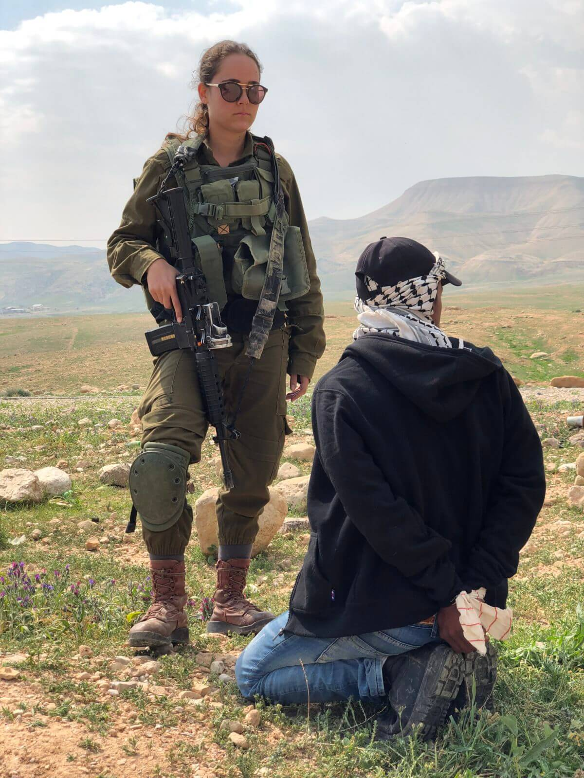 An Israeli soldier guards the Palestinian shepherd, Mohammed in the moments before he is taken to a nearby army base. (Photo: Antony Loewenstein)