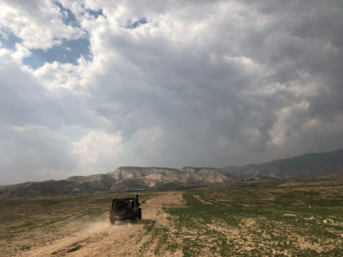 An Israeli army jeep crisscrosses the Jordan Valley, on daily patrol in the area. (Photo: Antony Loewenstein)