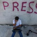 A photojournalist in Gaza. Photo: Majdi Fathi/APA Images.