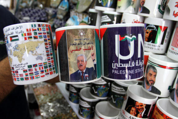 "Ahead of the 2011 Palestinian bid for statehood at the United Nations, a Palestinian shop sells coffee mugs displaying an the Palestinian President Mahmoud Abbas. One cup reads: ""The world wants a state of Palestine."" September 15, 2011, Gaza (Photo: Mohammed Asad/APA Images)"