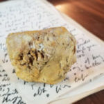 A rock from the West Bank village of Bil'in serves as a paperweight on Phil Weiss's desk.