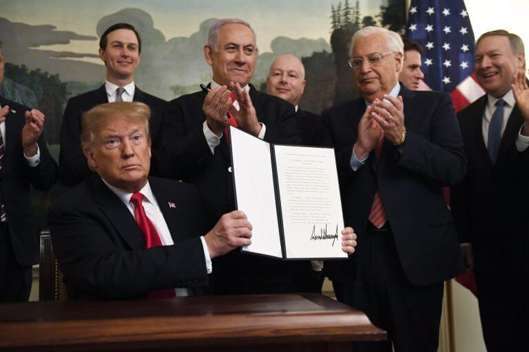 President Donald Trump holds up an executive proclamation recognizing the Golan Heights as Israeli territory at the White House in Washington DC, Monday, March 25, 2019. (Photo: Susan Walsh/AP)