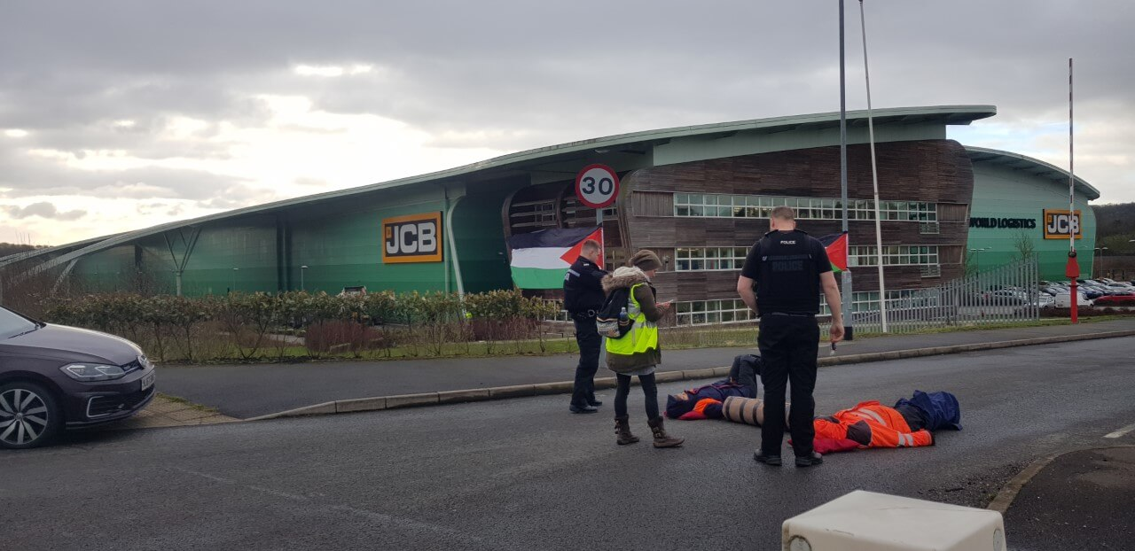 Manchester Action Palestine protesters lock arms outside of JCB World Logistic, Lowlands Rd, Stoke-on-Trent