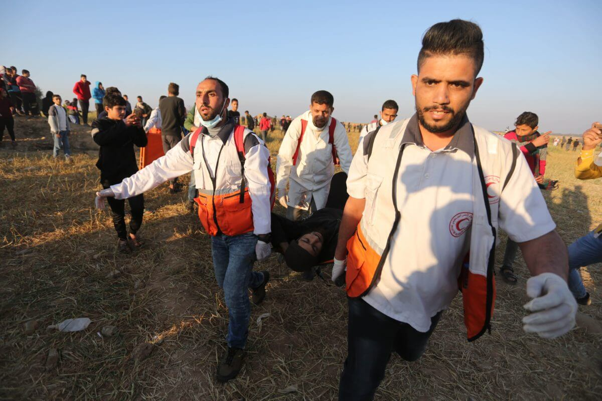 Injured person getting carried away from Gaza fence