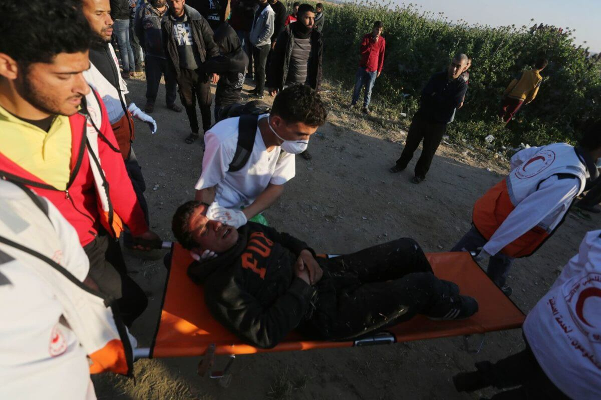 Injured youth is treated at a demonstration at the Gaza fence, March 22, 2019.