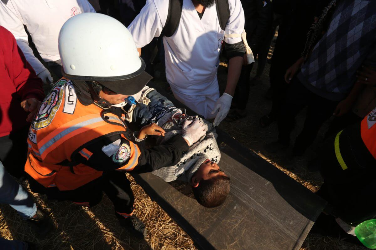 Injured youth is treated at a demonstration at the Gaza fence