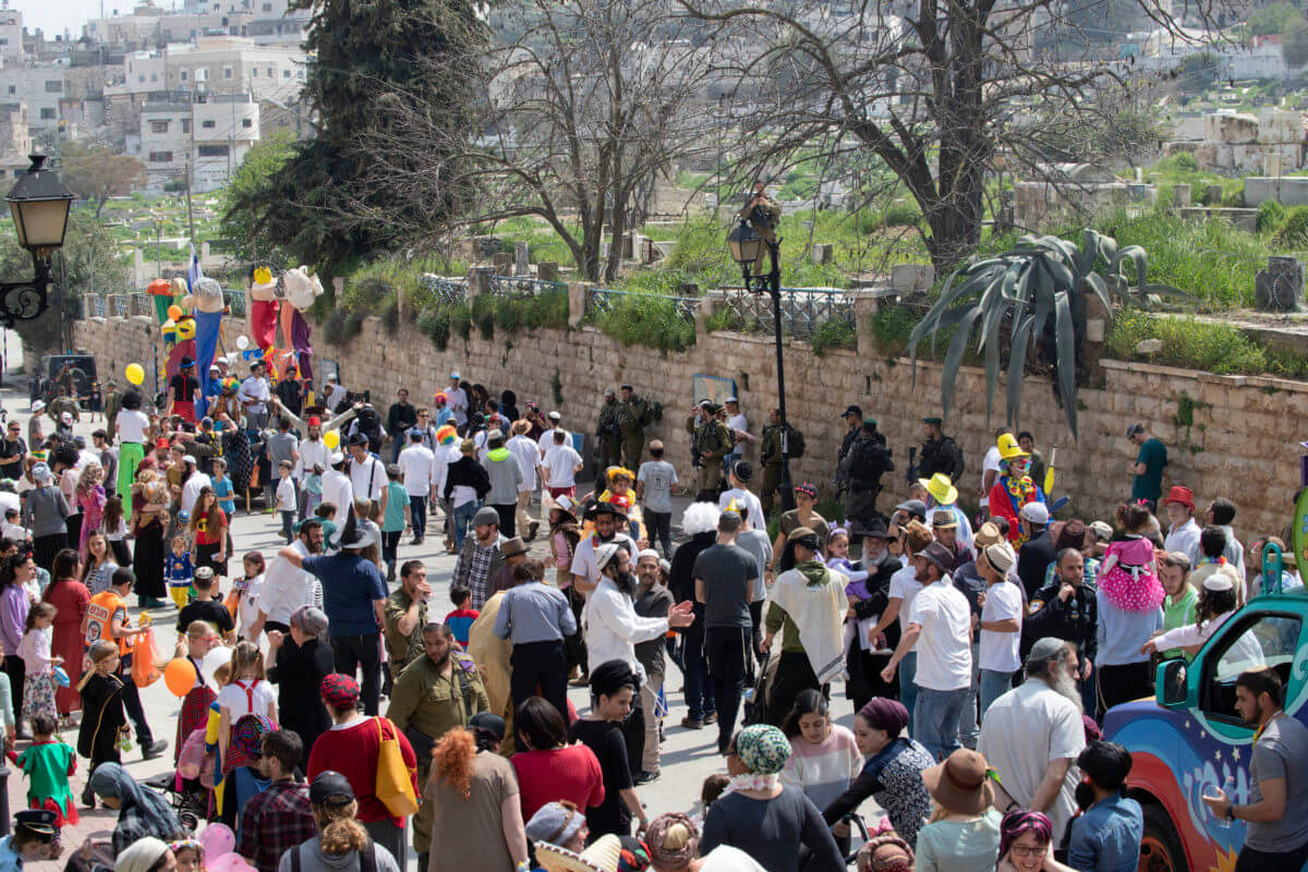 Around 300 Settlers march down Shuhada Street to the Ibrahimi mosque and the Cave of the Patriarchs to celebrate the Jewish holiday of Purim