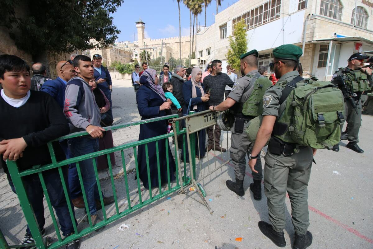 Israeli soldiers prevent Palestinians from accessing the area where the Purim march is taking place, March 21, 2019.