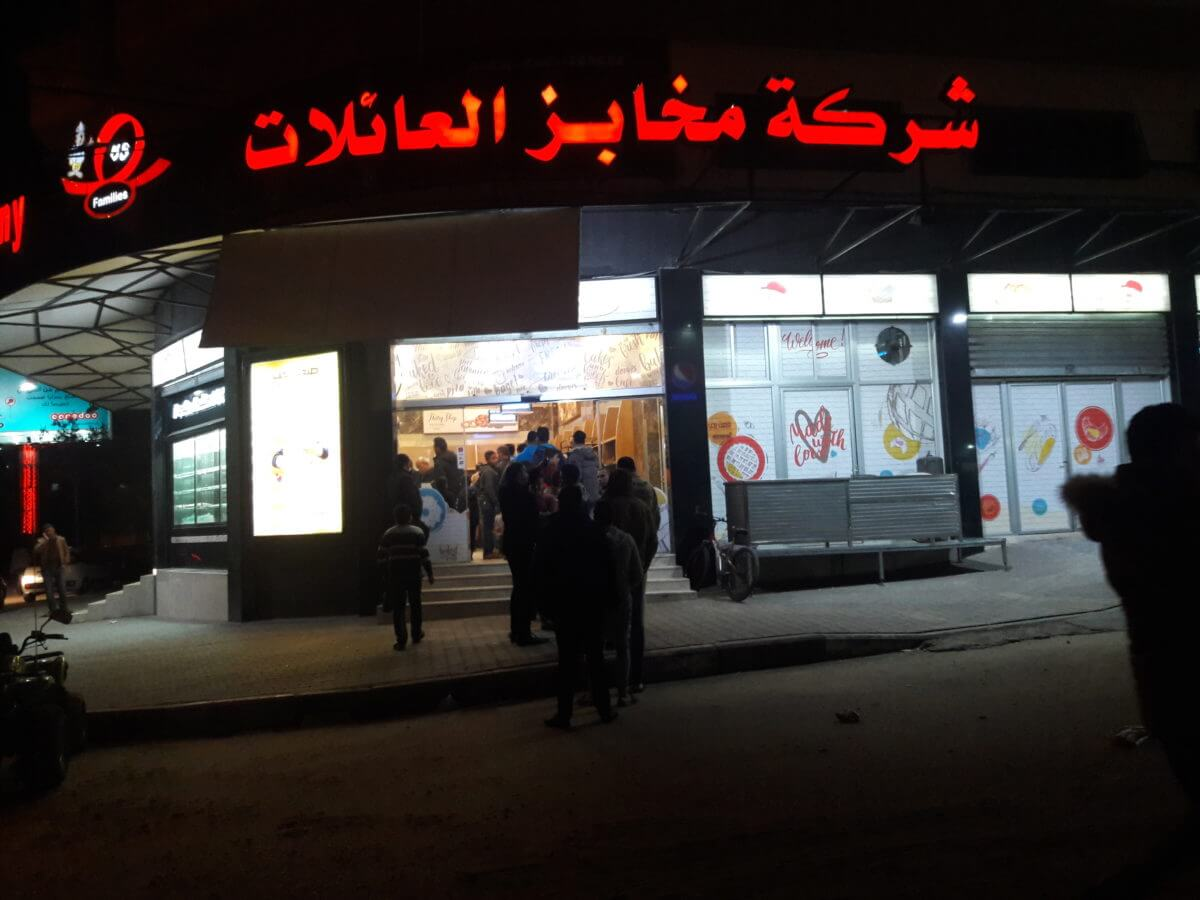 Spontaneous queues of people waiting out of Gaza bakeries following Israeli attacks.