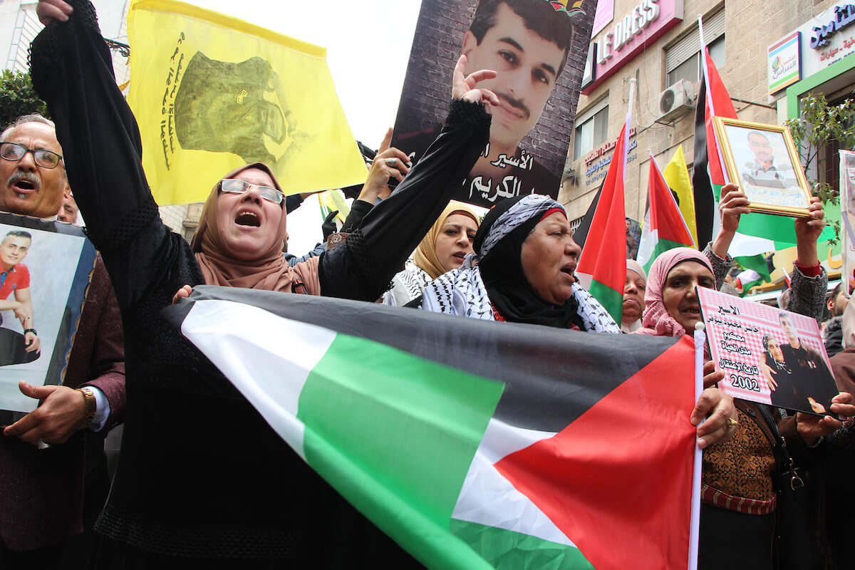 Palestinians take part in a Palestinian Prisoners' Day protest in the West Bank city of Ramallah