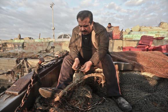 Palestinian fisherman Wayel al-Habeel at the Gaza Port. (Photo: Mohammed Assad)