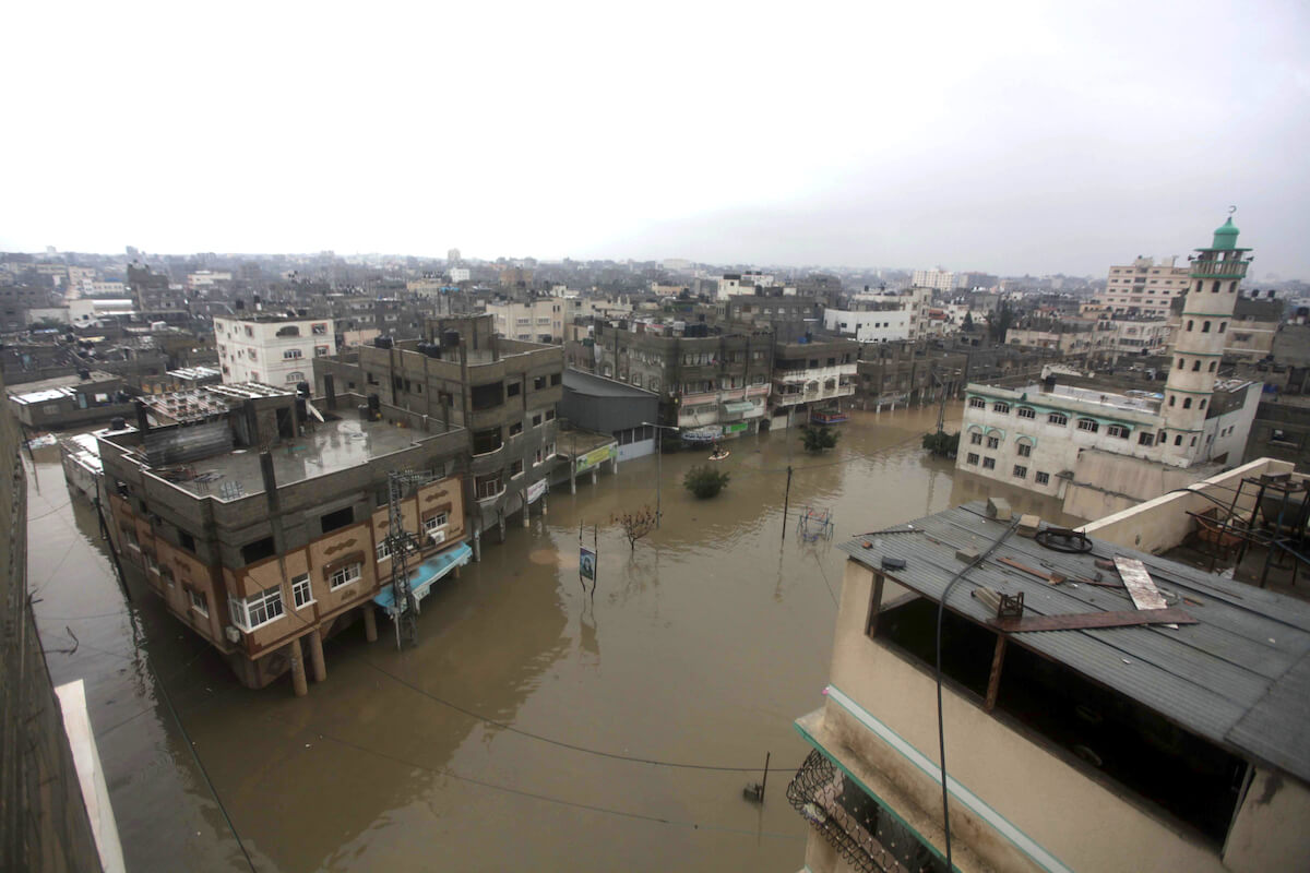 Rain waters flood parts of Gaza City on December 14, 2013. (Photo: Ashraf Amra/APA Images)