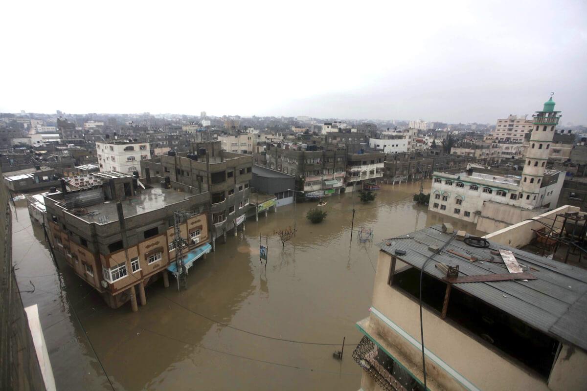 Rain waters flood parts of Gaza City on December 14, 2013. (Photo: Ashraf Amra/APA Images)