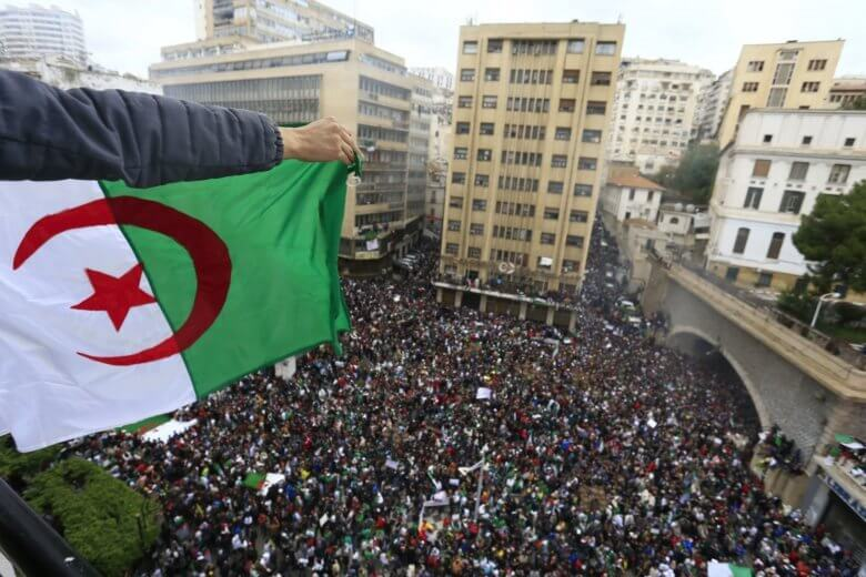 Algerians gather for a demonstration in Algiers, Friday, March 8, 2019