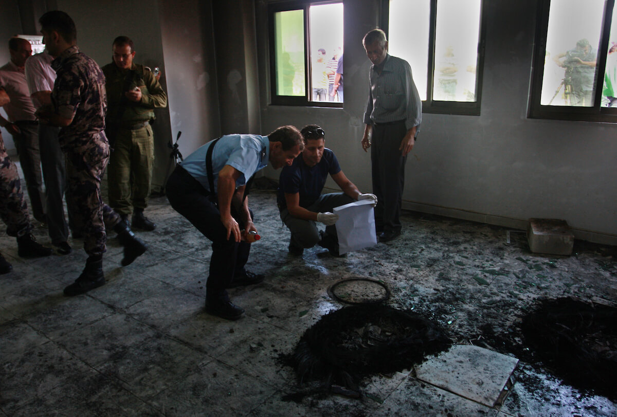 Palestinians and Palestinian security forces inspect the damage inside a mosque torched and vandalized by arsonists in the West Bank village of Qusra, near Nablus, Monday, Sept. 5, 2011. Arsonists tossed two tires into the first floor study hall of the mosque. (Photo: Wagdi Eshtayah/APA Images)