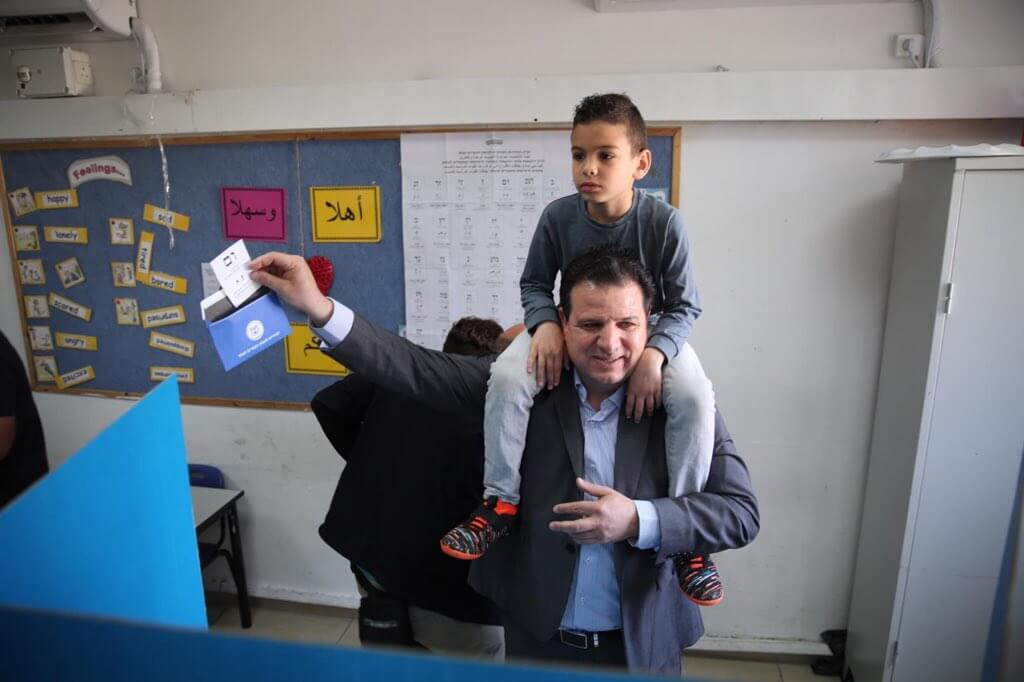 Head of the Hadash party, Ayman Odeh, casts his ballot on Tuesday morning. (Photo: Twitter)